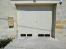 Porte double métallique automatisée avec aérations